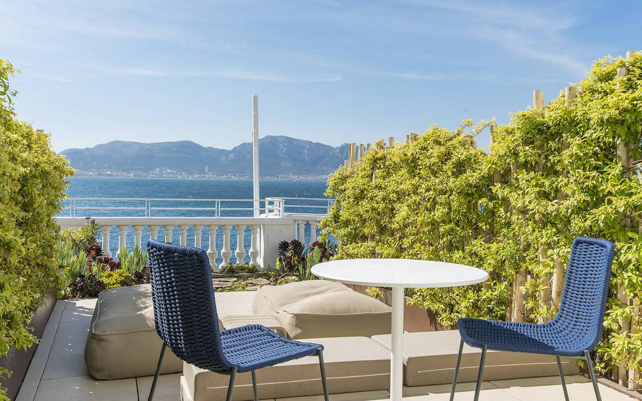 Terrace with table and chairs in a 5-star hotel in the French Riviera